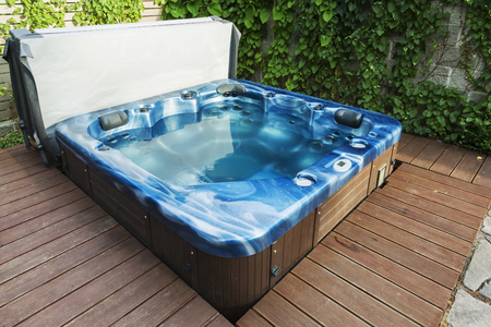 Photo for Outdoor hot tub, jacuzzi on the garden. - Royalty Free Image