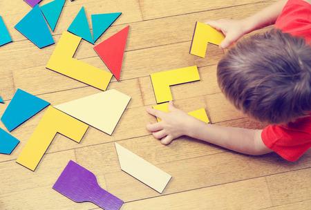 Photo pour little boy playing with puzzle, early education concept - image libre de droit