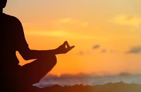 Foto de serenity and yoga practicing at sunset, meditation - Imagen libre de derechos