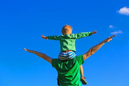 Foto de happy father and son having fun on sky - Imagen libre de derechos