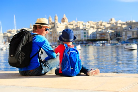 Foto de father and son looking at city of Valetta, Malta, family travel - Imagen libre de derechos