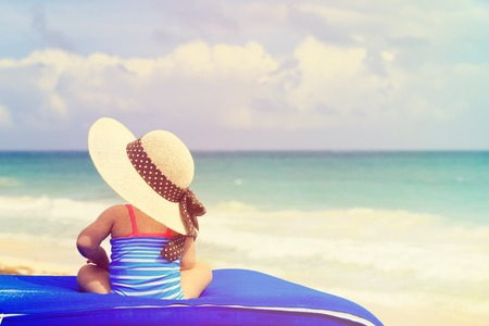 Photo for little girl in big hat on summer tropical beach - Royalty Free Image