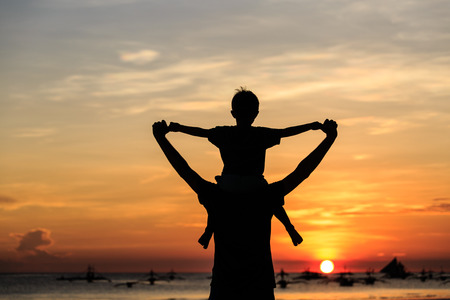 Photo for father and son on sky at sunset beach - Royalty Free Image
