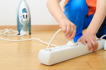 Foto de child playing with electricity, kids safety concept - Imagen libre de derechos