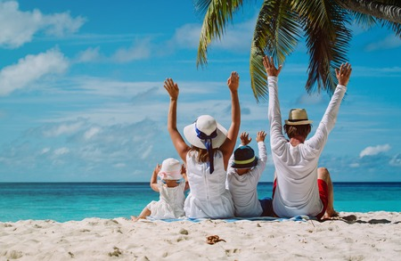 Photo pour happy family with two kids hands up on the beach, family beach vacation - image libre de droit