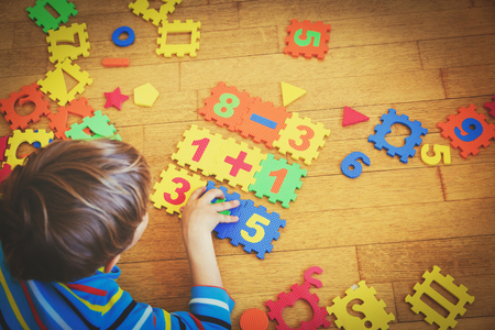 Photo for little boy playing with puzzle, education concept - Royalty Free Image