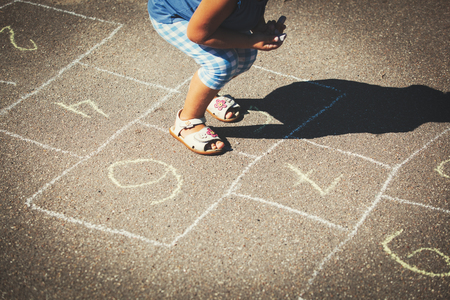 Photo for little girl playing hopscotch on playground - Royalty Free Image
