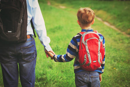 Photo for father walking son to school or daycare - Royalty Free Image