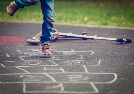 Photo for little boy playing hopscotch on playground - Royalty Free Image