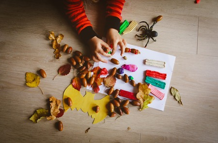 Photo pour Halloween preparation. Little girl making crafts from clay and natural materials - image libre de droit