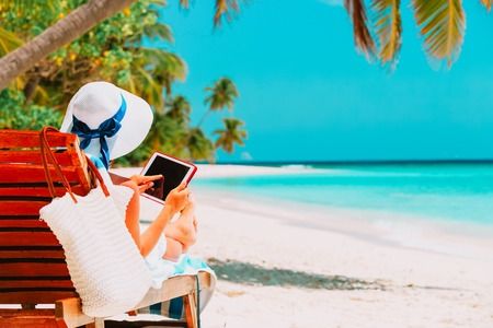 Photo for woman with touch pad on tropical beach - Royalty Free Image
