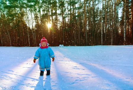 Foto de cute little toddler girl walk play in winter - Imagen libre de derechos
