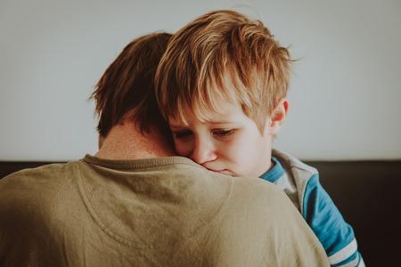 Foto de father comforting stressed sad son - Imagen libre de derechos