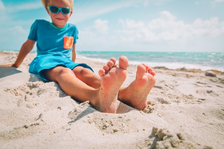 Photo for little boy relax at summer beach, focus on feet - Royalty Free Image
