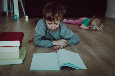 Photo pour difficult homeschooling- boy tired of homework, sister crying - image libre de droit