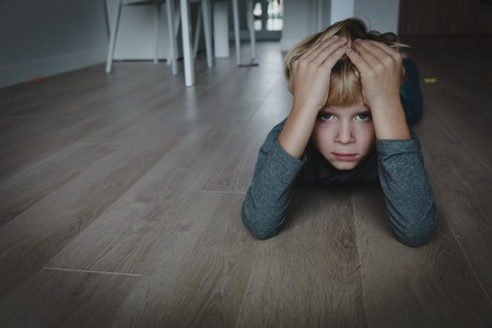 Photo pour sad stressed tired exhausted child at home - image libre de droit