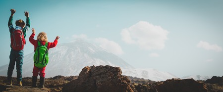 Photo for happy little boy and girl hiking in mountains - Royalty Free Image