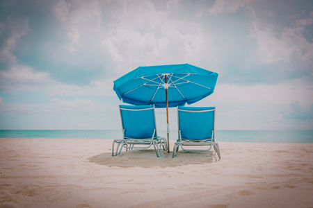 Foto de Two beach chairs on tropical vacation at sea - Imagen libre de derechos