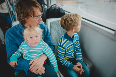 Foto per father with kids travel by bus, family using public transport - Immagine Royalty Free