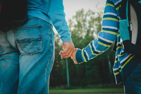 Foto de father walking son to school or daycare - Imagen libre de derechos