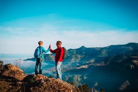 Foto de father and son travel in nature, family hiking in mountains - Imagen libre de derechos