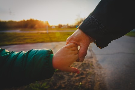 Photo pour grandmother holding grandchild hand in nature, parenting concept - image libre de droit