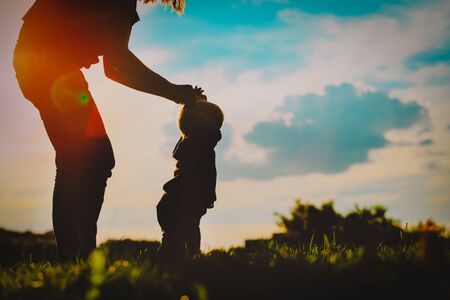 Photo for mother and baby making first steps at sunset - Royalty Free Image