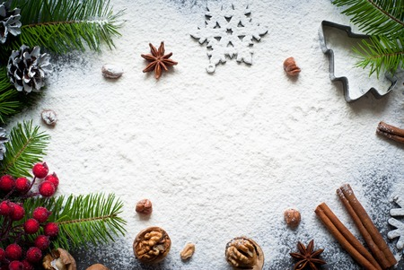 Photo pour Ingredients for christmas baking - flour, spices and cookie cutters. - image libre de droit