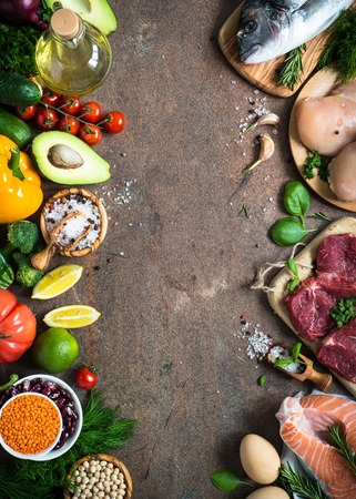 Photo pour Balanced diet food background. Organic food for healthy nutrition. Meat fish beans and vegetables. Top view on dark stone table. - image libre de droit