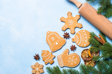 Photo for Christmas baking background. Christmas gingerbread cookies and spices on blue table. Top view. - Royalty Free Image