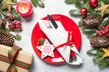 Photo for Christmas table setting  with plate, silverware and decorations over gray stone table. Top view. - Royalty Free Image