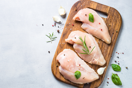 Photo for Raw chicken fillet with spices and herbs top view. - Royalty Free Image