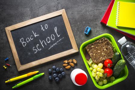 Foto de School and office stationery on black background. - Imagen libre de derechos