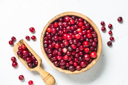Photo for Cranberry in wooden bowl on white background. - Royalty Free Image