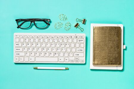 Photo for Office workplace with keyboard, notepad, glasses and pen - Royalty Free Image