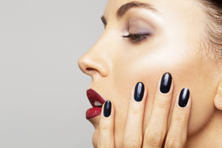 Photo pour Beauty Portrait Woman close-up with perfect make-up. Beautiful Spa model Girl with Perfect Fresh Clean Skin and black nail polish. Youth and Skin Care Concept - image libre de droit