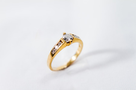 Photo for Diamond engagement gold ring with white isolated background - Royalty Free Image