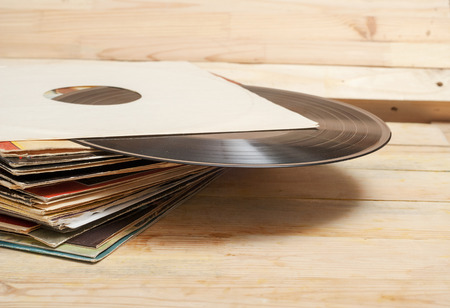 Photo pour Vinyl record with copy space in front of a collection of albums dummy titles, vintage process - image libre de droit
