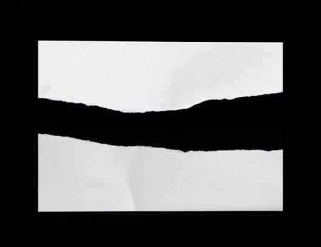 Foto de Torn pieces of paper on black background - Imagen libre de derechos