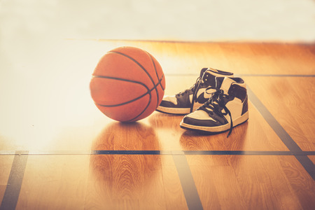Photo pour Basketball court with ball and shoes - image libre de droit