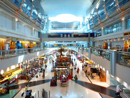 DUBAI, UAE - OCTOBER 08: Travellers at Dubai International Airport Terminal 1 October 08, 2010 in Dubai, United Arab Emirates. Dubai Airport is one of the world's busiest airport.