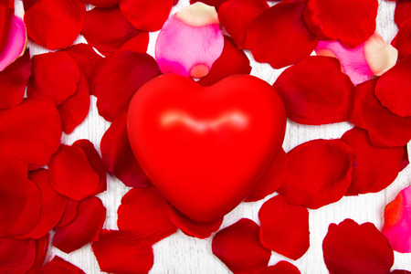 Photo for Rose petals and red heart - Royalty Free Image