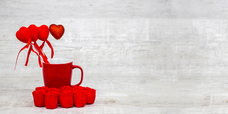 Photo for Shiny red coffee cup and red roses on wooden - Royalty Free Image