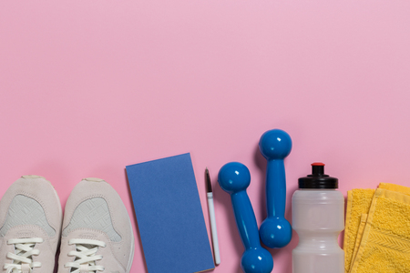 sport, fitness, healthy lifestyle and objects concept - close up of sneakers, dumbbells