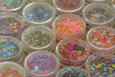 Photo for Multi colored Sequins for the design of nails in a Jar. Glitter in jars. Foil for nail service. Photo set. Sparkling beauty shimmer, glitter. Bright background of glitter. Top view. - Royalty Free Image