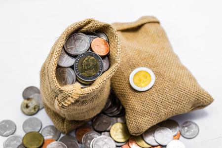 Foto de Thai baht money in sack isolated on white background - Imagen libre de derechos