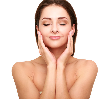 Photo pour Beautiful spa woman with clean beauty skin touching her face with closed eyes  Beauty natural model - image libre de droit