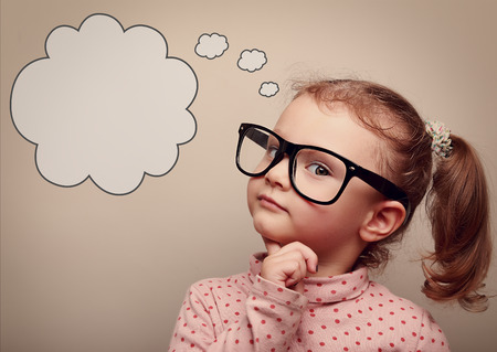 Photo pour Smart kid in glasses thinking with speech bubble above with empty copy space. Vintage portrait - image libre de droit