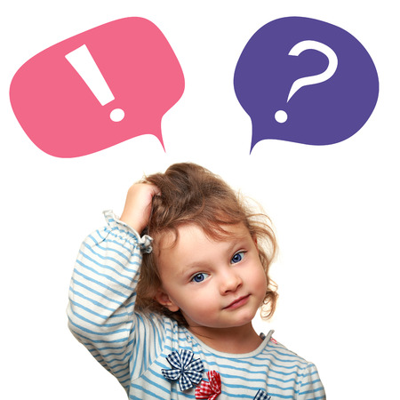 Foto de Thinking cute small kid girl with question and exclamation signs in bubbles isolated on white background - Imagen libre de derechos