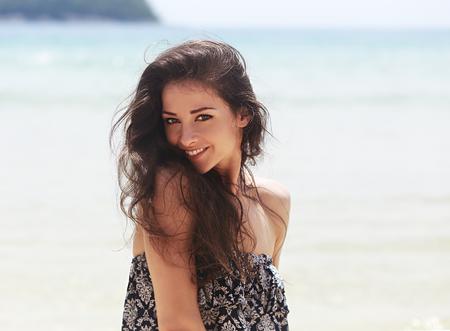 Photo pour Beautiful toothy smiling woman joying on blue sea background - image libre de droit